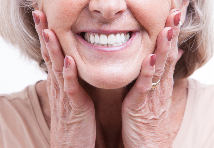 A woman smiling after receiving Root Canal Therapy in Chicago, IL